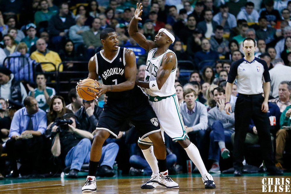 28 November 2012: Brooklyn Nets shooting guard Joe Johnson (7) looks to pass the ball over Boston Celtics shooting guard Jason Terry (4) during the Brooklyn Nets 95-83 victory over the Boston Celtics at the TD Garden, Boston, Massachusetts, USA.