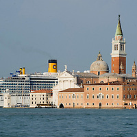 VENICE, ITALY - MAY 02:  A giant cruise ship sails behind Isola di S Giorgio on May 1, 2011 in Venice, Italy. Giant cruise ships passing through  St Mark Basin and Giudecca Canal are causing continue controversy for the possible damages to the lagoon and Venice buildings