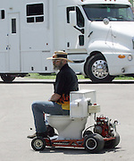 David W. Smith/ Daily News<br /> Tom Cunningham from Dayton OH, demonstrates the motorized toilet he has for sale during the Hot Rod Reunion Thursday at Beech Bend Campground.
