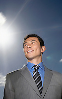 Smiling Young Businessman standing outside low angle view