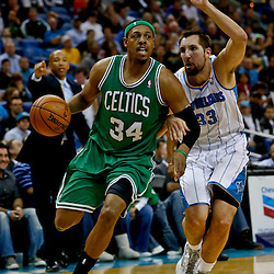 Mar 20, 2013; New Orleans, LA, USA; Boston Celtics small forward Paul Pierce (34) drives past New Orleans Hornets power forward Ryan Anderson (33) during the second half of a game at the New Orleans Arena. The Hornets defeated the Celtics 87-86. Mandatory Credit: Derick E. Hingle-USA TODAY Sports