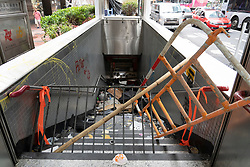 Kowloon, Hong Kong, China,. 7 October, 2019. After a night of violent confrontations between police and pro-democracy protestors in MongKok and YauMaTei in Kowloon, many MTR railway stations and what are thought to be pro-Beijing business franchises were vandalised. Entrance to MTR station vandalised.