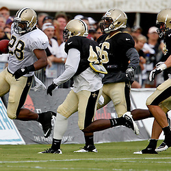 July 28, 2012; Metairie, LA, USA; New Orleans Saints running back Mark Ingram (28) runs against the defense during a training camp practice at the team's practice facility. Mandatory Credit: Derick E. Hingle-US PRESSWIRE
