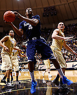 WEST LAFAYETTE, IN - DECEMBER 01: Travis Taylor #4 of the Xavier Musketeers puts up a shot under the basket against the Purdue Boilermakers at Mackey Arena on December 1, 2012 in West Lafayette, Indiana. Xavier defeated Purdue 63-57. (Photo by Michael Hickey/Getty Images) *** Local Caption *** Travis Taylor