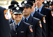 Lisa Cusimano lines up with fellow probationary firefighters for the FDNY firefighter graduation at Queens College on Friday, Nov. 6, 2015 in Flushing, N.Y. Cusimano was one of four women to graduate. Photo by Kathy Kmonicek