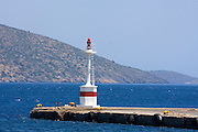Greece, Crete, red light tower at the entrance to a harbour The red light marks the left side of the entrance as the ship comes in