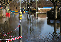 © Licensed to London News Pictures. 24/02/2014. Basingstoke, Hampshire, UK. Floodwater on Grampian Way in the Buckskin area of Basingstoke, Hampshire. Groundwater levels are continuing to rise in the area, forcing 69 homes to be evacuated in the Buckskin Area of the commuter town. Photo credit : Rob Arnold/LNP