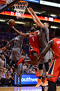 Feb 13, 2017; Phoenix, AZ, USA; New Orleans Pelicans guard Tyreke Evans (1) goes up with the ball in front of Phoenix Suns center Alex Len (21) in the second half of the NBA game at Talking Stick Resort Arena. The New Orleans Pelicans won 110-108. Mandatory Credit: Jennifer Stewart-USA TODAY Sports
