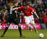 Photo: Chris Ratcliffe.<br />Charlton Athletic v Brentford. The FA Cup. 18/02/2006.<br />Darren Ambrose (R) of Charlton tussles with Michael Turner of Brentford.