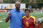UCLA Bruins coach Avery Anderson (left) and Southern California Trojans coach Caryl Smith Gilbert pose during an NCAA college dual meet in Los Angeles, Sunday, April 28, 2019.