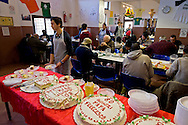 ROME, ITALY  -  DECEMBER 17:   Voluntaries with cake offered by Pope Francis to the poor of the Colle Oppio canteen. Pope Francis celebrates 80 years with 1500 guests of Rome's Caritas, offering cakes to be included in the menu with the meal that is delivered on December 17, 2016 in Rome, Italy.