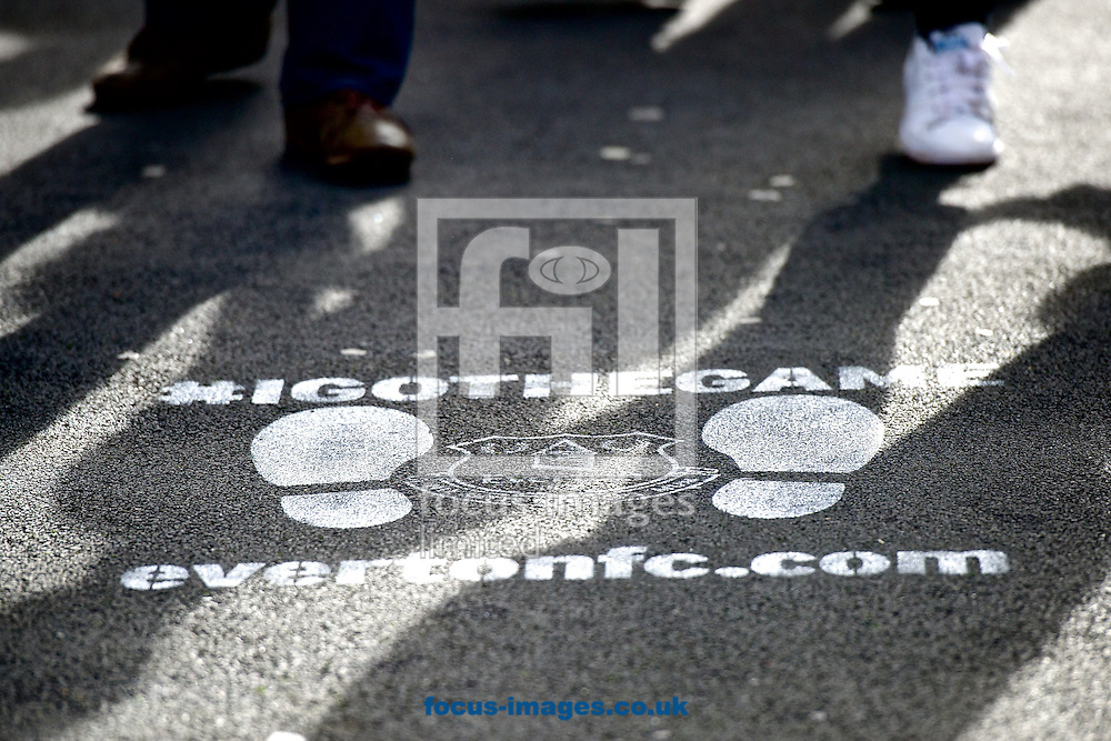 General view of the exterior of the stadium showing Everton marketing message on pavement as fans make their way to the game pictured ahead of the Barclays Premier League match at Goodison Park, Liverpool<br /> Picture by Ian Wadkins/Focus Images Ltd +44 7877 568959<br /> 18/10/2014