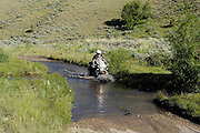 Crossing a low water stream high in the Montana Rockies