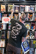 Jimmy Dowell of Morgan Hill looks at new comic books during Free Comic Book Day at Black Cat Comics in Milpitas, California, on May 6, 2017. (Stan Olszewski/SOSKIphoto)