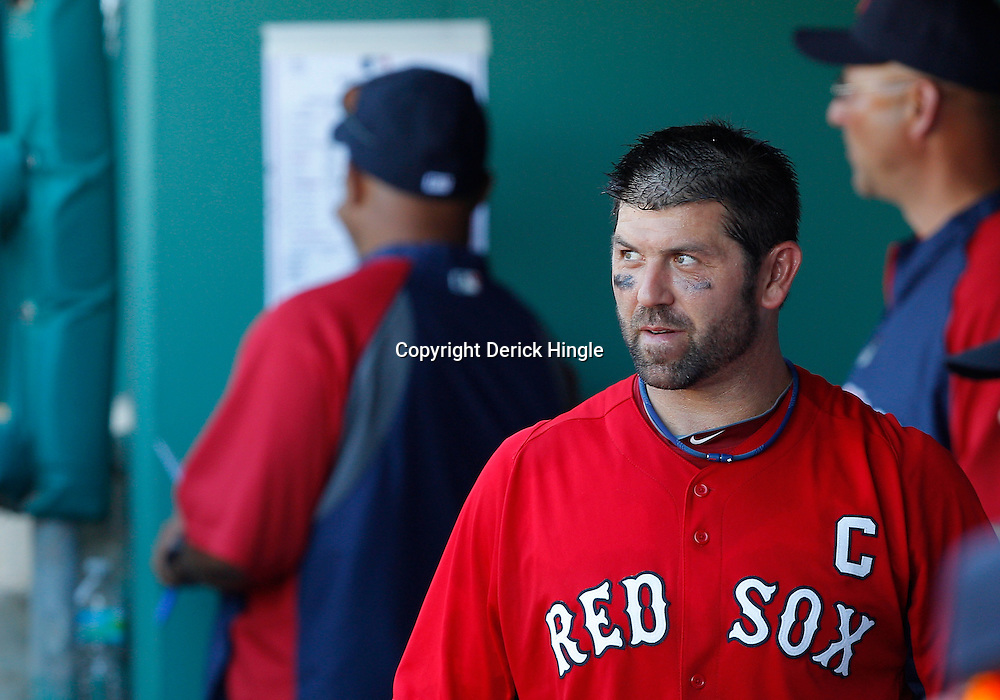 February 28, 2011; Fort Myers, FL, USA; Boston Red Sox catcher Jason Varitek (33) in the dug out during a spring training exhibition game against the Minnesota Twins at City of Palms Park.  Mandatory Credit: Derick E. Hingle