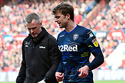 Patrick Bamford (9) of Leeds United talks to a physio after gettiing injured while scoring a goal to give a 0-1 lead to the away team during the EFL Sky Bet Championship match between Bristol City and Leeds United at Ashton Gate, Bristol, England on 9 March 2019.