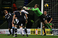 Photo: Paul Thomas.<br /> Bolton Wanderers v West Ham United. The Barclays Premiership. 09/12/2006.<br /> <br /> Kevin Davis (Behind West Ham's Christian Dailly 7) scores his second goal for Bolton, which can't be stopped by keeper Robert Green (Green).