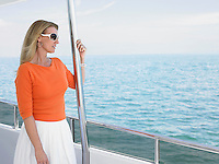 Middle-aged woman on yacht