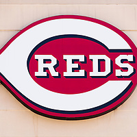 Photo of Cincinnati Reds logo sign on the Great American Ball Park stadium wall. The Cincinnati Reds are the Major League Baseball (MLB) team for Cincinnati, Ohio and were established in 1881.