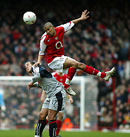 Photo. Chris Ratcliffe, Digitalsport<br /> Arsenal v Stoke City. FA Cup Third Round. <br /> 09/01/2005<br /> Arsenals Gael Clichy goes up with Stoke's Darel Russell
