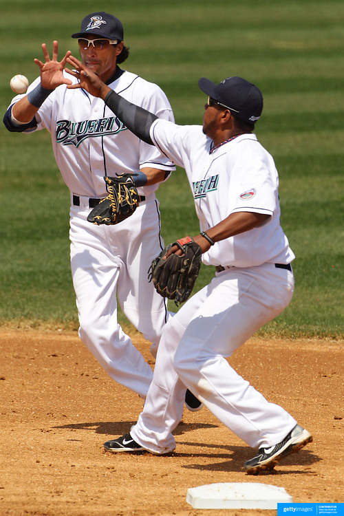 Infielders Brandon Chaves, (left) and Daniel Mayora attempt to field the ball during the Bridgeport Bluefish V York Revolution, Atlantic League, Minor League ballgame at Harbor Yard Ballpark, Bridgeport, Connecticut, USA. Photo Tim Clayton