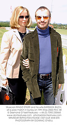 Musician RINGO STARR and his wife BARBARA BACH, at a polo match in Surrey on 19th May 2002.PAC 48
