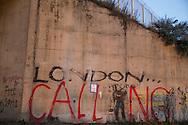 Calais, Pas-de-Calais, France - 17.10.2016    <br />     <br /> &quot;London calling&quot;  graffiti near the &rdquo;Jungle&quot; refugee camp on the outskirts of the French city of Calais. Many thousands of migrants and refugees are waiting in some cases for years in the port city in the hope of being able to cross the English Channel to Britain. French authorities announced that they will shortly evict the camp where currently up to up to 10,000 people live.<br /> <br /> &quot;London calling&quot;-Graffiti nahe des &rdquo;Jungle&rdquo; Fluechtlingscamp am Rande der franzoesischen Stadt Calais. Viele tausend Migranten und Fluechtlinge harren teilweise seit Jahren in der Hafenstadt aus in der Hoffnung den Aermelkanal nach Gro&szlig;britannien ueberqueren zu koennen. Die franzoesischen Behoerden kuendigten an, dass sie das Camp, indem derzeit bis zu bis zu 10.000 Menschen leben K&uuml;rze raeumen werden. <br /> <br /> Photo: Bjoern Kietzmann