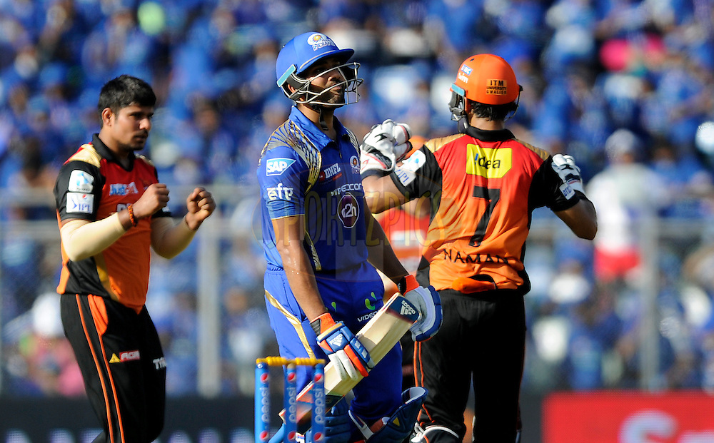 Rohit Sharma captain of Mumbai Indians walks back dejected as Karn Sharma of Sunrisers Hyderabad celebrates his wicket during match 23 of the Pepsi IPL 2015 (Indian Premier League) between The Mumbai Indians and The Sunrisers Hyferabad held at the Wankhede Stadium in Mumbai India on the 25th April 2015.<br /> <br /> Photo by:  Pal Pillai / SPORTZPICS / IPL