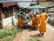18 SEPTEMBER 2015 - BANGKOK, THAILAND: A vendor makes som tam (papaya salad with crabs) for Buddhist novices from a nearby temple in the neighborhood near Wat Kalayanamit. Fiftyfour homes around Wat Kalayanamit, a historic Buddhist temple on the Chao Phraya River in the Thonburi section of Bangkok are being razed and the residents evicted to make way for new development at the temple. The abbot of the temple said he was evicting the residents, who have lived on the temple grounds for generations, because their homes are unsafe and because he wants to improve the temple grounds. The evictions are a part of a Bangkok trend, especially along the Chao Phraya River and BTS light rail lines. Low income people are being evicted from their long time homes to make way for urban renewal.             PHOTO BY JACK KURTZ