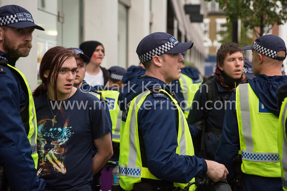 Metropolitan Police officers detain students who had been attending a National Demonstration for a Free Education on 4th November 2015 in London, United Kingdom. The demonstration was organised by the National Campaign Against Fees and Cuts (NCAFC) in protest against tuition fees and the Government's plans to axe maintenance grants with effect from 2016.