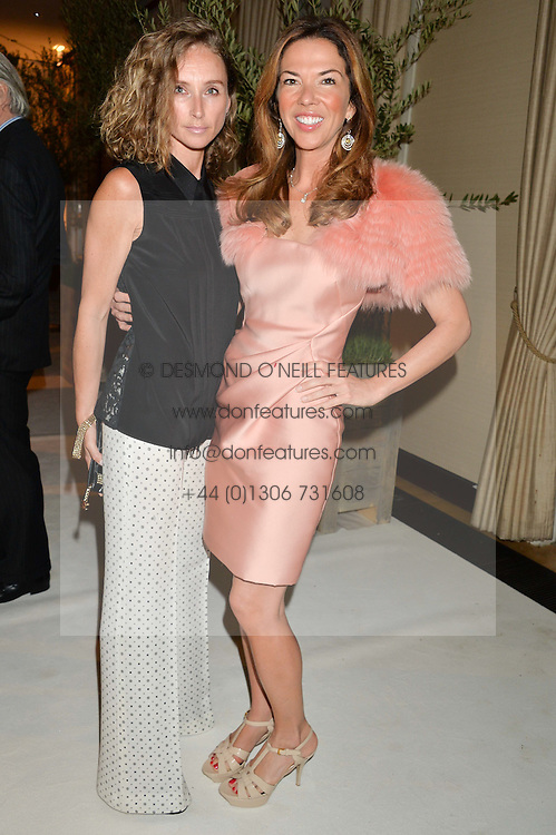 Left to right, JO MANOUKIAN and HEATHER KERZNER at a dinner hosted by Cartier in celebration of The Chelsea Flower Show held at The Hurlingham Club, London on 19th May 2014.