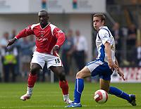 Photo: Daniel Hambury.<br />Charlton Athletic v Portsmouth. The Barclays Premiership. 16/09/2006.<br />Charlton's Jimmy Floyd Hasselbaink pushes the ball past Portsmouth's Shaun Davis.