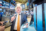 At the NYSE Euronext Stock Exchange, floor specialist Peter M. Tuchman with Quattro Securities starts trading again after the announcement that the federal interest rate would increase.