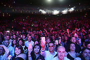 LAS VEGAS, NV - DECEMBER 28:  Singer Pitbull performs in front of a packed house during his New Year's Eve weekend concert series at The Pearl concert theatre at the Palms Casino Resort on December 28, 2012 in Las Vegas, Nevada.  (Photo by Jeff Bottari/WireImage)