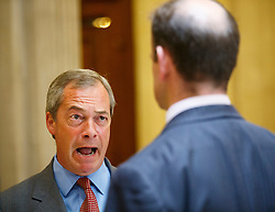 "© Licensed to London News Pictures. 17/06/2015. London, UK. UKIP leader NIGEL FARAGE talking to UKIP MP DOUGLAS CARSWELL before launching ""The Truth About Trade Beyond The EU"" pamphlet in central London, on Wednesday, June 17, 2015. Photo credit: Tolga Akmen/LNP"