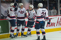 REGINA, SK - MAY 23: Robbie Holmes #32, Matt Bradley #77, Sam Steel #23 and Nick Henry #21 of the Regina Pats celebrate a goal against the Swift Current Broncos at the Brandt Centre on May 23, 2018 in Regina, Canada. (Photo by Marissa Baecker/CHL Images)