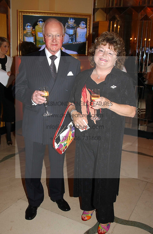 CAROLE NASH founder and executive chairman of Carle Nash Insurance with her husband FRED NASH at the 2005 Clicquot Award - Business Woman of The Year award ceremony held at Claridge's, Brook Street, London W1 on 28th April 2005.