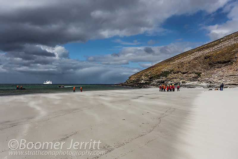 An approaching storm makes for a difficult landing on a wind swept beach on Saunders Island.  Falkland Islands.