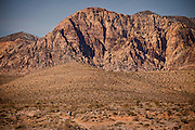 A mountain biker rides through the high desert area of Red Rock Canyon outside Las Vegas, Nevada.