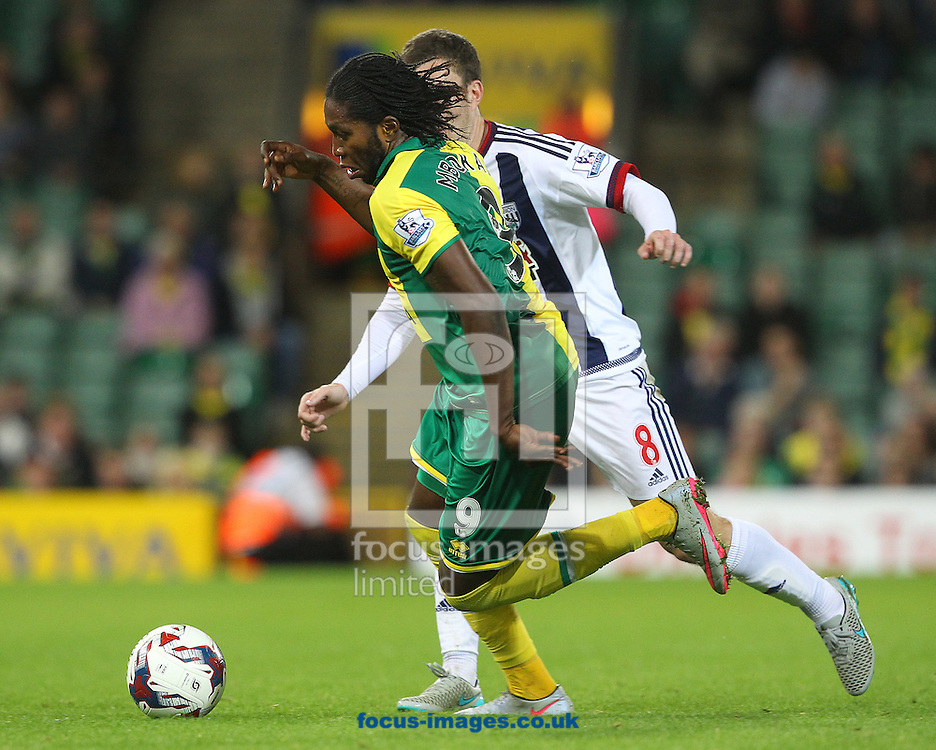 Dieumerci Mbokani of Norwich and Craig Gardner of West Bromwich Albion in action during the Capital One Cup match at Carrow Road, Norwich<br /> Picture by Paul Chesterton/Focus Images Ltd +44 7904 640267<br /> 23/09/2015