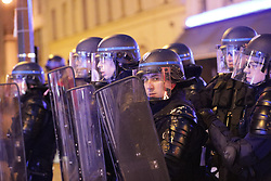 © Licensed to London News Pictures . 17/04/2017 . Paris , France . Antifascist protesters opposed to a meeting by Marine le Pen's French far-right party , Front National , clash with riot police at the Zénith Paris arena . Photo credit : Joel Goodman/LNP