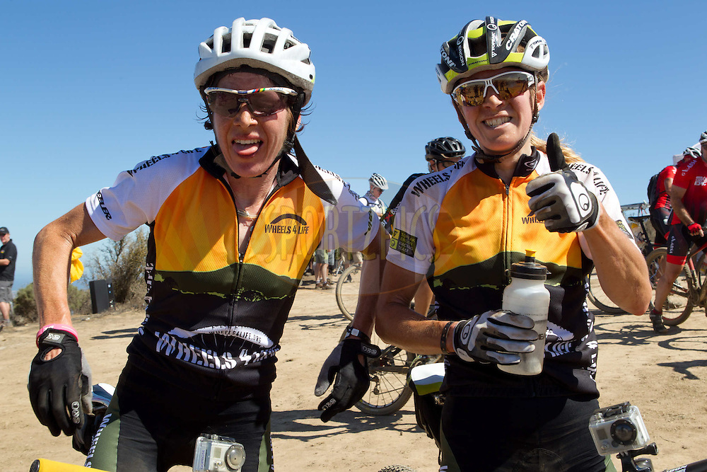 Esther Suss tired and Sally Bigham (of Team Wheels4Life) happy to take the ladies leaders jersey after the Prologue of the 2012 Absa Cape Epic Mountain Bike stage race held at Meerendal Wine Estate in Durbanville outside Cape Town, South Africa on the 25 March 2012..Photo by Greg Beadle/Cape Epic/SPORTZPICS