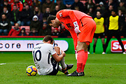 Kane injured - Harry Kane (10) of Tottenham Hotspur clutches his leg in pain after clashing with Asmir Begovic (27) of AFC Bournemouth during a offside goal during the Premier League match between Bournemouth and Tottenham Hotspur at the Vitality Stadium, Bournemouth, England on 11 March 2018. Picture by Graham Hunt.