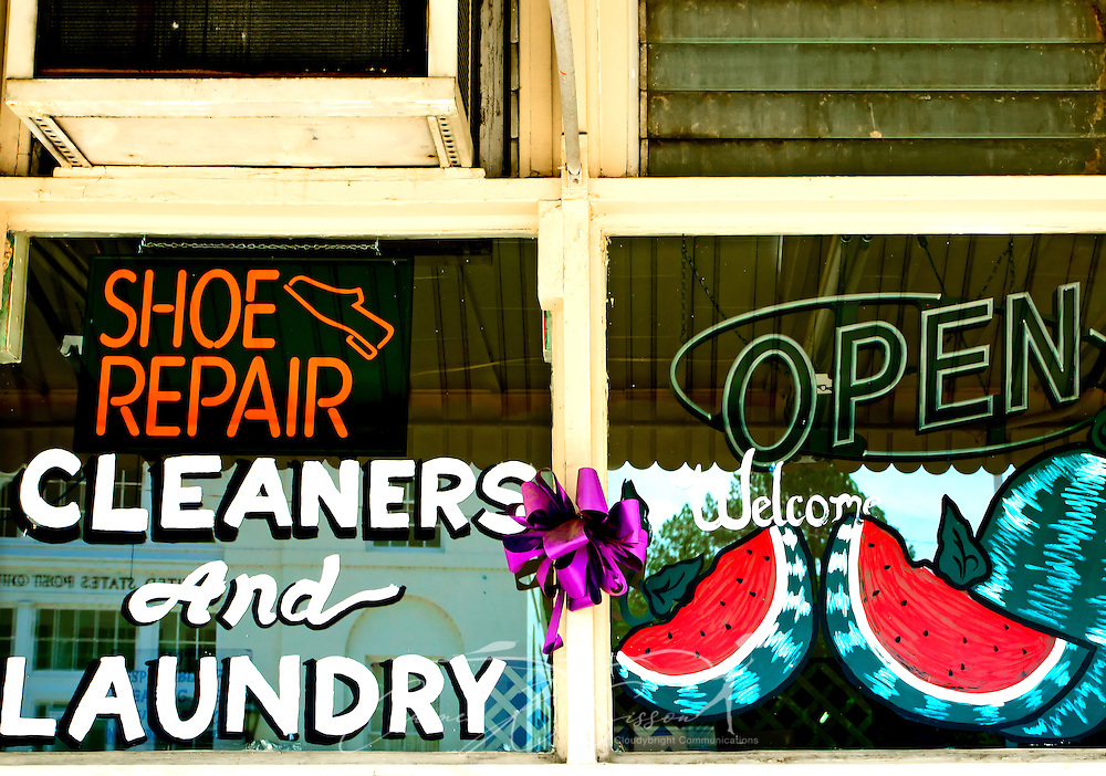 A painted window advertises shoe repair, dry cleaning, laundry services in Water Valley, Mississippi. (Photo by Carmen K. Sisson/Cloudybright)
