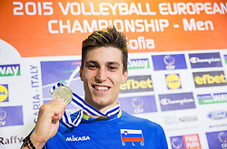 Klemen Cebulj #18 of Slovenia  celebrates after trophy ceremony after Slovenia placed 2nd after volleyball match between National teams of Slovenia and France at Final match of 2015 CEV Volleyball European Championship - Men, on October 18, 2015 in Arena Armeec, Sofia, Bulgaria. Photo by Vid Ponikvar / Sportida