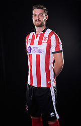 Lincoln City Football Club kit launch ahead of the 2017/18 EFL Sky Bet League Two season.  Pictured is Lincoln City's Luke Waterfall wearing the red and white Errea home shirt, with the Bishop Grosseteste University logo on the front.<br /> <br /> Picture: Chris Vaughan Photography<br /> Date: June 19, 2017