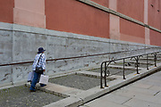 A lady carries shopping bags up the steps on Miklosiceva Cesta (street) in the Slovenian capital, Ljubljana, on 28th June 2018, in Ljubljana, Slovenia.