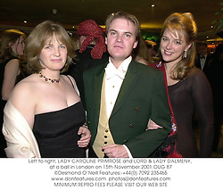 Left to right, LADY CAROLINE PRIMROSE and LORD & LADY DALMENY, at a ball in London on 15th November 2001.	OUG 87