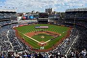 An American flag is unfurled on the field during a September 11th memorial ceremony that included the New York City Pipes and Drums at Yankee Stadium before the baseball game against the Tampa Bay Rays, Sunday, Sept. 11, 2016, in New York.<br />  (AP Photo/Kathy Kmonicek)