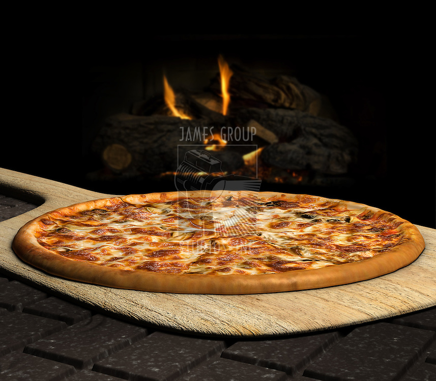 Pizza resting on a pizza peel near an open fire